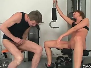 Sexy babe has extra stretching after workout with her coach